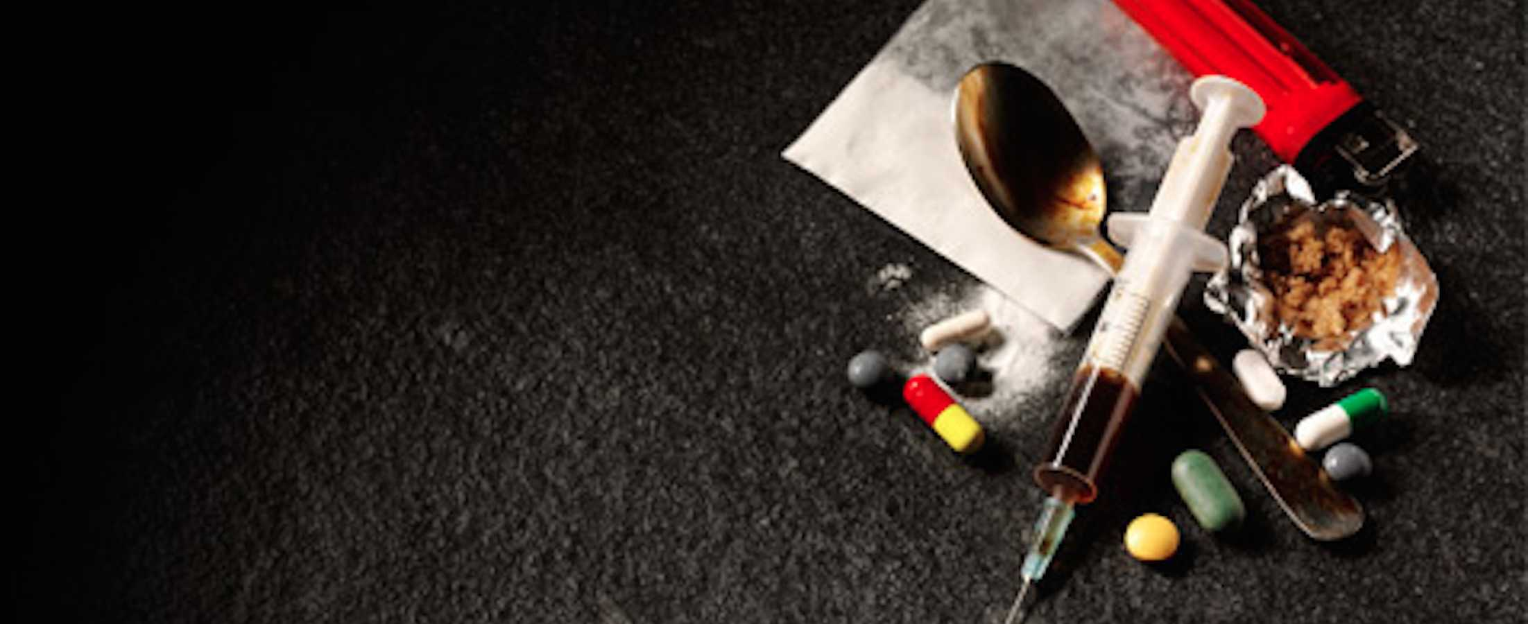 addiction paraphernalia like needle, spoon, pills and powders